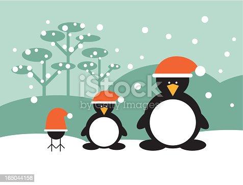 """istock """"Globi"""" penguin family christmas 165044158"""