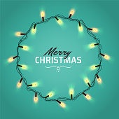 Glowing Christmas realistic Lights Wreath for Xmas Holiday Greeting Cards Design. Isolated on red background. Merry Christmas Lettering label. Glowing lights Garlands Xmas Holiday greeting card design