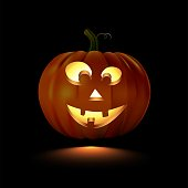 Glowing Halloween pumpkin with smiling face isolated on black background. Vector design element