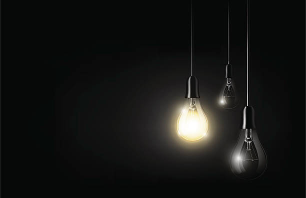 Glowing light bulb hanging between turned off light bulbs, vector vector art illustration