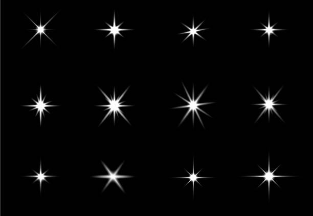 efekt świecących świateł, flary, eksplozji i gwiazd. efekt specjalny izolowany na czarnym tle - migoczący stock illustrations
