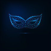 Glowing low polygonal carnival masquerade mask made of lines, stars, triangular shapes isolated on dark blue background. Futuristic wireframe design vector illustration.