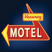 Glowing motel sign with light bulbs