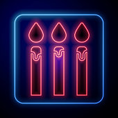 Glowing neon Birthday cake candles icon isolated on blue background. Vector Illustration