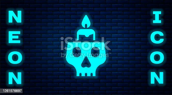 Glowing neon Burning candle on a skull icon isolated on brick wall background. Day of dead. Vector.