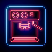 Glowing neon Coffee machine icon isolated on blue background. Vector Illustration