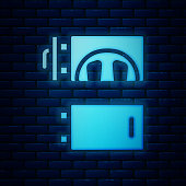Glowing neon Crematorium icon isolated on brick wall background. Vector
