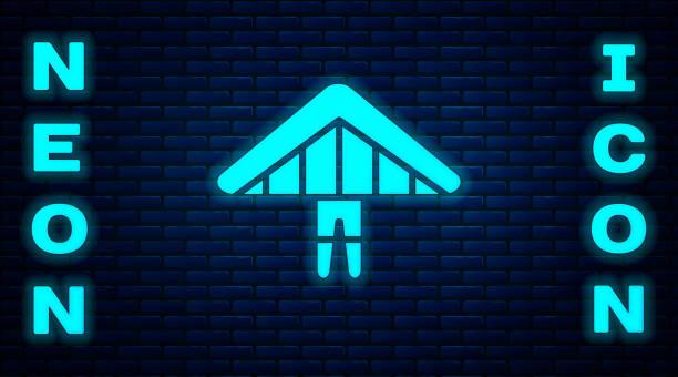 ilustrações, clipart, desenhos animados e ícones de ícone de planador de néon brilhante isolado no fundo da parede de tijolos. esporte extremo. ilustração vetorial - ícones de design planar