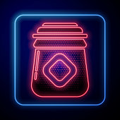 istock Glowing neon Jar of honey icon isolated on blue background. Food bank. Sweet natural food symbol. Vector Illustration 1254402071