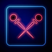 istock Glowing neon Knitting needles icon isolated on blue background. Label for hand made, knitting or tailor shop. Vector Illustration 1224151874