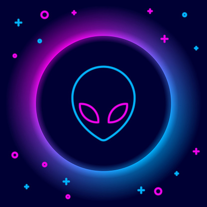 Glowing neon line Alien icon isolated on black background. Extraterrestrial alien face or head symbol. Colorful outline concept. Vector