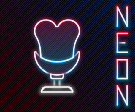Glowing neon line Armchair icon isolated on black background. Colorful outline concept. Vector.