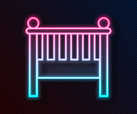 Glowing neon line Baby crib cradle bed icon isolated on black background. Vector Illustration