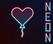 Glowing neon line Balloon in form of heart with ribbon icon isolated on black background. Valentines day. Colorful outline concept. Vector Illustration