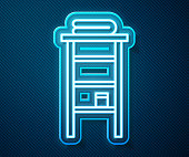 Glowing neon line Bathroom rack with shelves for towels icon isolated on blue background. Furniture object for bath room interior. Vector Illustration