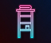 Glowing neon line Bathroom rack with shelves for towels icon isolated on black background. Furniture object for bath room interior. Vector Illustration