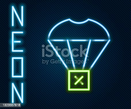 istock Glowing neon line Box flying on parachute icon isolated on black background. Parcel with parachute for shipping. Delivery service, air shipping. Colorful outline concept. Vector 1323557618