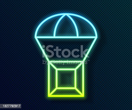istock Glowing neon line Box flying on parachute icon isolated on black background. Parcel with parachute for shipping. Delivery service, air shipping. Vector 1327792917