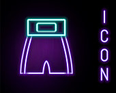 istock Glowing neon line Boxing short icon isolated on black background. Colorful outline concept. Vector 1296372325
