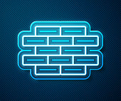 Glowing neon line Bricks icon isolated on blue background. Vector Illustration
