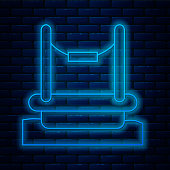 istock Glowing neon line Bungee trampoline attraction with metal ladder icon isolated on brick wall background. Vector 1316653107