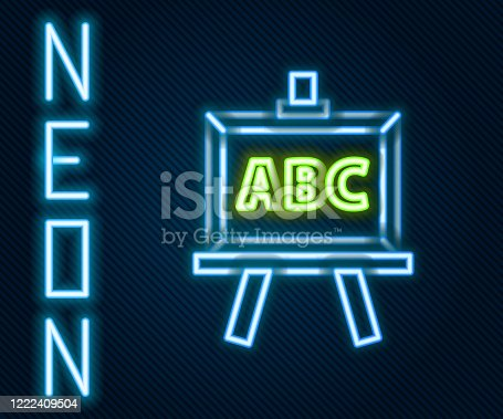 istock Glowing neon line Chalkboard icon isolated on black background. School Blackboard sign. Colorful outline concept. Vector Illustration 1222409504
