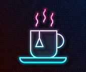 Glowing neon line Cup of tea with tea bag icon isolated on black background. Vector Illustration