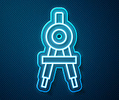 istock Glowing neon line Drawing compass icon isolated on blue background. Compasses sign. Drawing and educational tools. Geometric instrument. Vector Illustration 1267677341