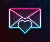 istock Glowing neon line Envelope with Valentine heart icon isolated on black background. Message love. Letter love and romance. Vector Illustration 1266450865