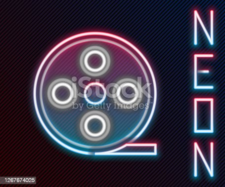Glowing neon line Film reel icon isolated on black background. Colorful outline concept. Vector Illustration