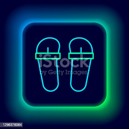 istock Glowing neon line Flip flops icon isolated on black background. Beach slippers sign. Colorful outline concept. Vector 1296376064