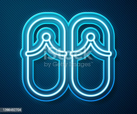 istock Glowing neon line Flip flops icon isolated on blue background. Beach slippers sign. Vector Illustration 1266452704