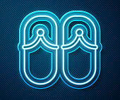 Glowing neon line Flip flops icon isolated on blue background. Beach slippers sign. Vector Illustration