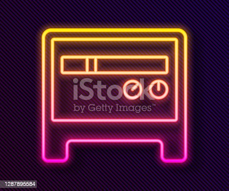 Glowing neon line Guitar amplifier icon isolated on black background. Musical instrument. Vector.