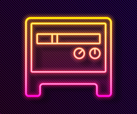 Glowing neon line Guitar amplifier icon isolated on black background. Musical instrument. Vector
