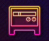 istock Glowing neon line Guitar amplifier icon isolated on black background. Musical instrument. Vector 1287895584