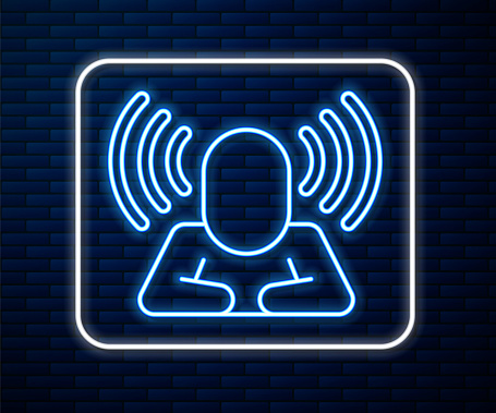 Glowing neon line Head hunting icon isolated on brick wall background. Business target or Employment sign. Human resource and recruitment for business. Vector