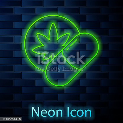 Glowing neon line Herbal ecstasy tablets icon isolated on brick wall background. Vector Illustration