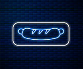 Glowing neon line Hotdog sandwich icon isolated on brick wall background. Sausage icon. Fast food sign. Vector Illustration