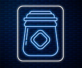 istock Glowing neon line Jar of honey icon isolated on brick wall background. Food bank. Sweet natural food symbol. Vector Illustration 1253901539