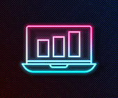 Glowing neon line Laptop with graph chart icon isolated on black background. Report text file icon. Accounting sign. Audit, analysis, planning. Vector Illustration