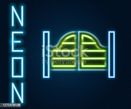 Glowing neon line Old western swinging saloon door icon isolated on black background. Colorful outline concept. Vector.