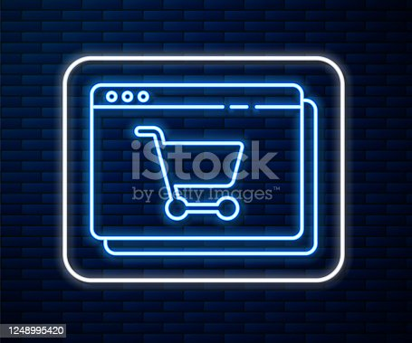 istock Glowing neon line Online shopping on screen icon isolated on brick wall background. Concept e-commerce, e-business, online business marketing. Vector Illustration 1248995420