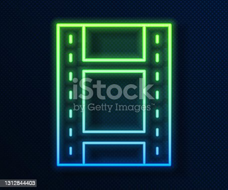 istock Glowing neon line Play Video icon isolated on blue background. Film strip sign. Vector 1312844403