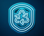 istock Glowing neon line Recycle symbol inside shield icon isolated on blue background. Eco protection sign. Vector Illustration 1248993089
