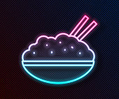 istock Glowing neon line Rice in a bowl with chopstick icon isolated on black background. Traditional Asian food. Vector Illustration 1271398782