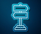 istock Glowing neon line Road traffic sign. Signpost icon isolated on blue background. Pointer symbol. Isolated street information sign. Direction sign. Vector Illustration 1267677105