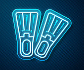 Glowing neon line Rubber flippers for swimming icon isolated on blue background. Diving equipment. Extreme sport. Sport equipment. Vector Illustration