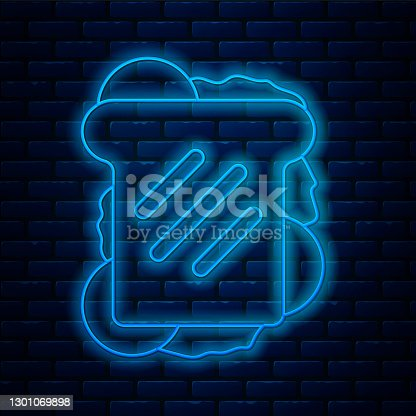 istock Glowing neon line Sandwich icon isolated on brick wall background. Hamburger icon. Burger food symbol. Cheeseburger sign. Street fast food menu. Vector 1301069898