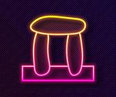 Glowing neon line Stonehenge icon isolated on black background. Vector.